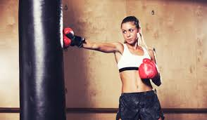 women punching bag workouts